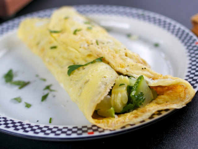 Omelette stuffed with Goat Cheese, Summer Squash and Parsley