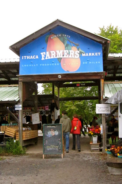 An early spring visit. Bobby and Emma walk into the Ithaca Farmers Market, which is perched on Cayuga Lake, complete with a boat landing and docks to picnic with your fresh bounty.