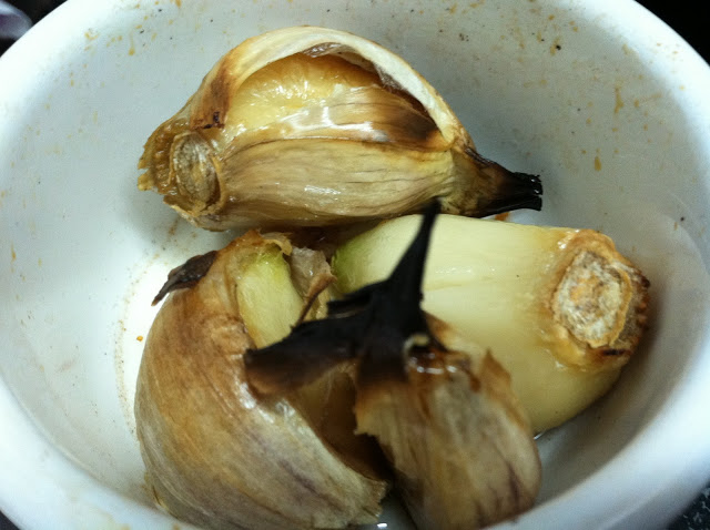 Roast some garlic in a dish with olive oil and lather it on fresh bread.