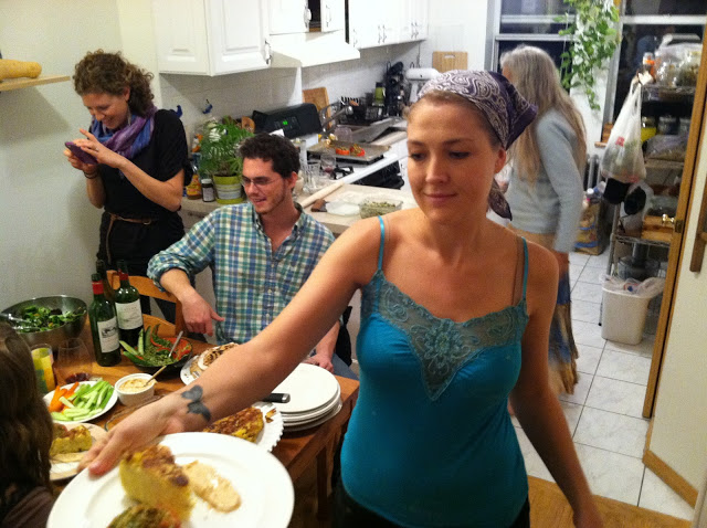 Shanti, the beautiful host, doling out plates. (Me, busted taking blog shots in the background).