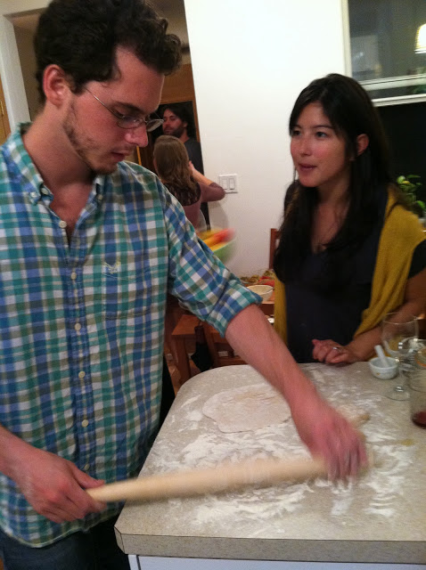 Bobby rolls out the naan dough, while Dolores gives him moral support!