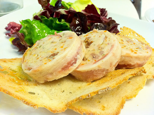 Just to taste. Rabbit Terrine on crostini with olive oil. Great but hearty. This was shared in bite-sized morsels.