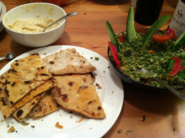 Naan with Dolores' famous garlic-hummus, and Shanti's dad's (Byron) super-green-spicy dip (kale, parsley, jalapenos galore!).
