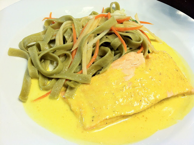 I save this for last, the least extraordinary dish (likely due to the preceding flavors). Poached salmon in a saffron-butter sauce with spinach tagliatelle and julienned vegetables. Missing: salt.