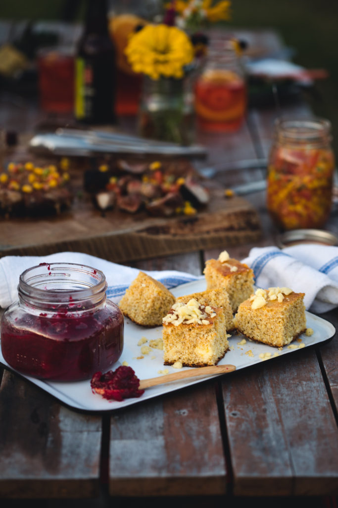 Crock-perfected gluten-free cheddar cornbread with cranberry-orange and maple jam by Emma Frisch using Barebones Living cast iron crock pot