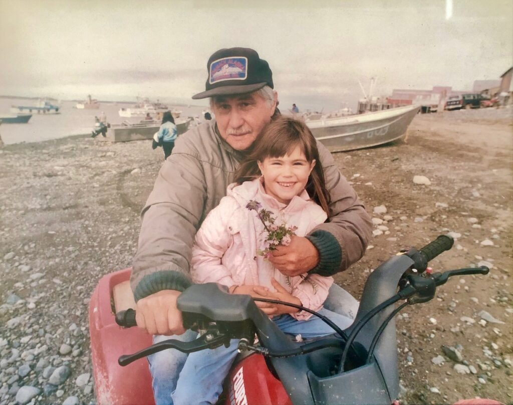Anna hoover and john hoover on a dirt bike at Bristol Bay