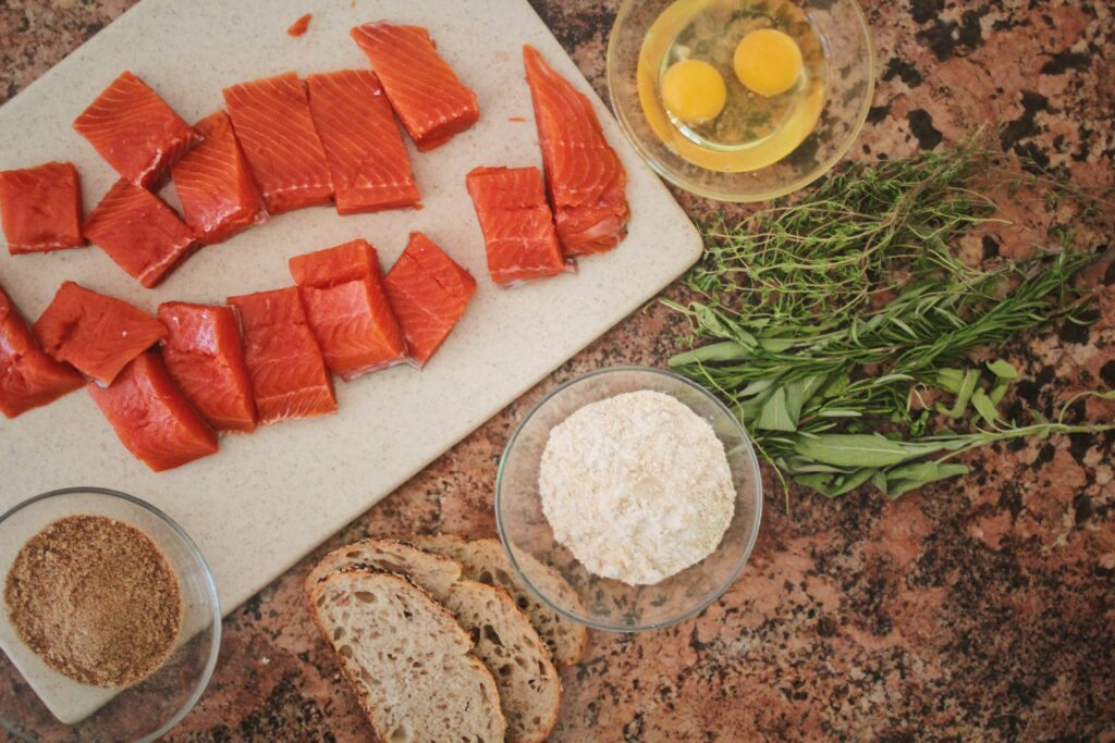 Raw Wild Alaskan Salmon Pieces and ingredients for salmon cutlets