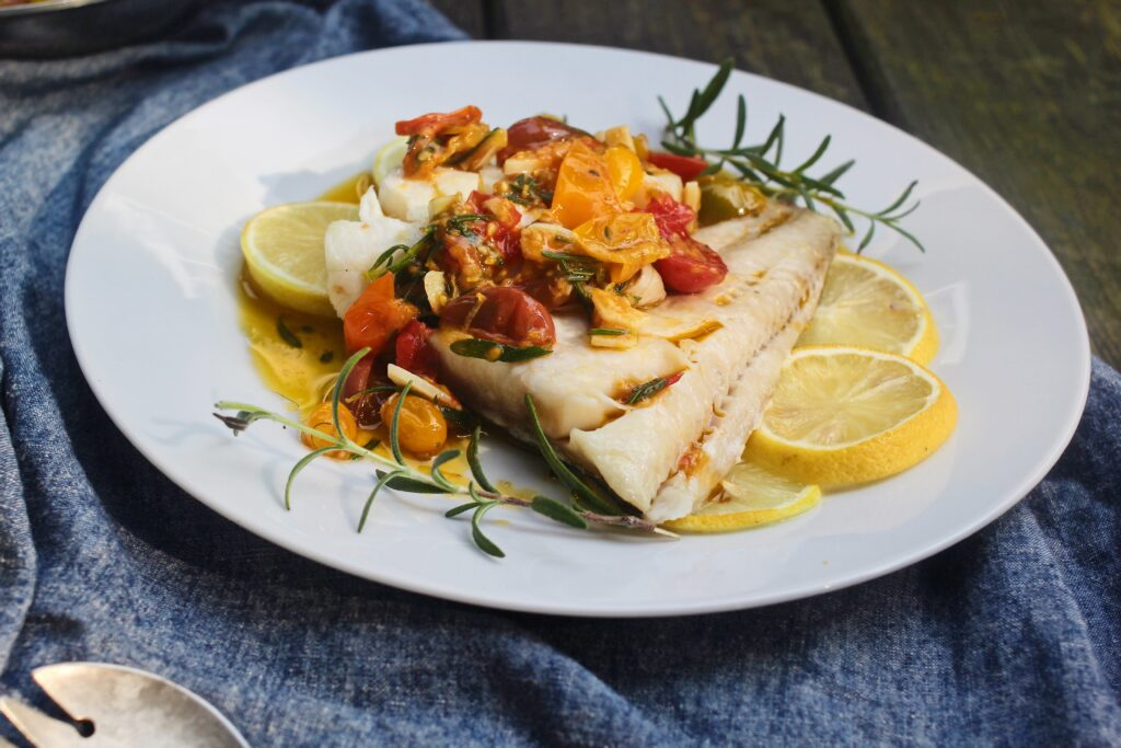 Baked Alaskan Black Cod with Lemon-Rosemary Braised Tomatoes with Roasted Acorn Squash